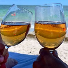 Two glasses of rosé on beach