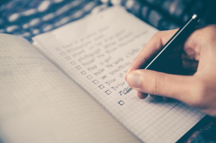 Person making a handwritten list