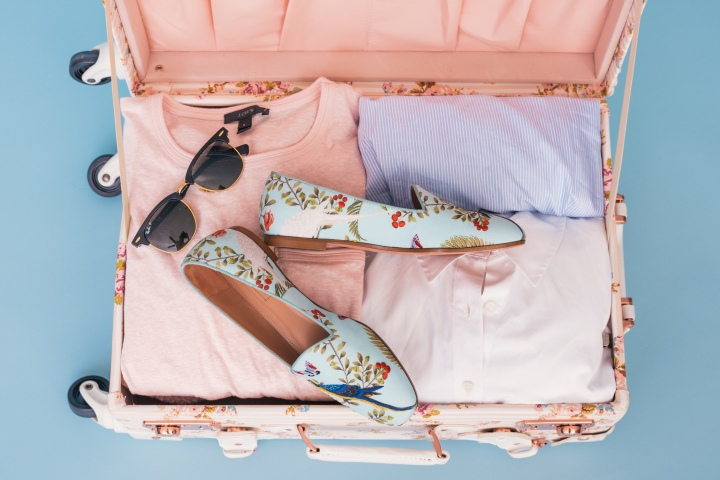 Shoes and clothing in pink luggage