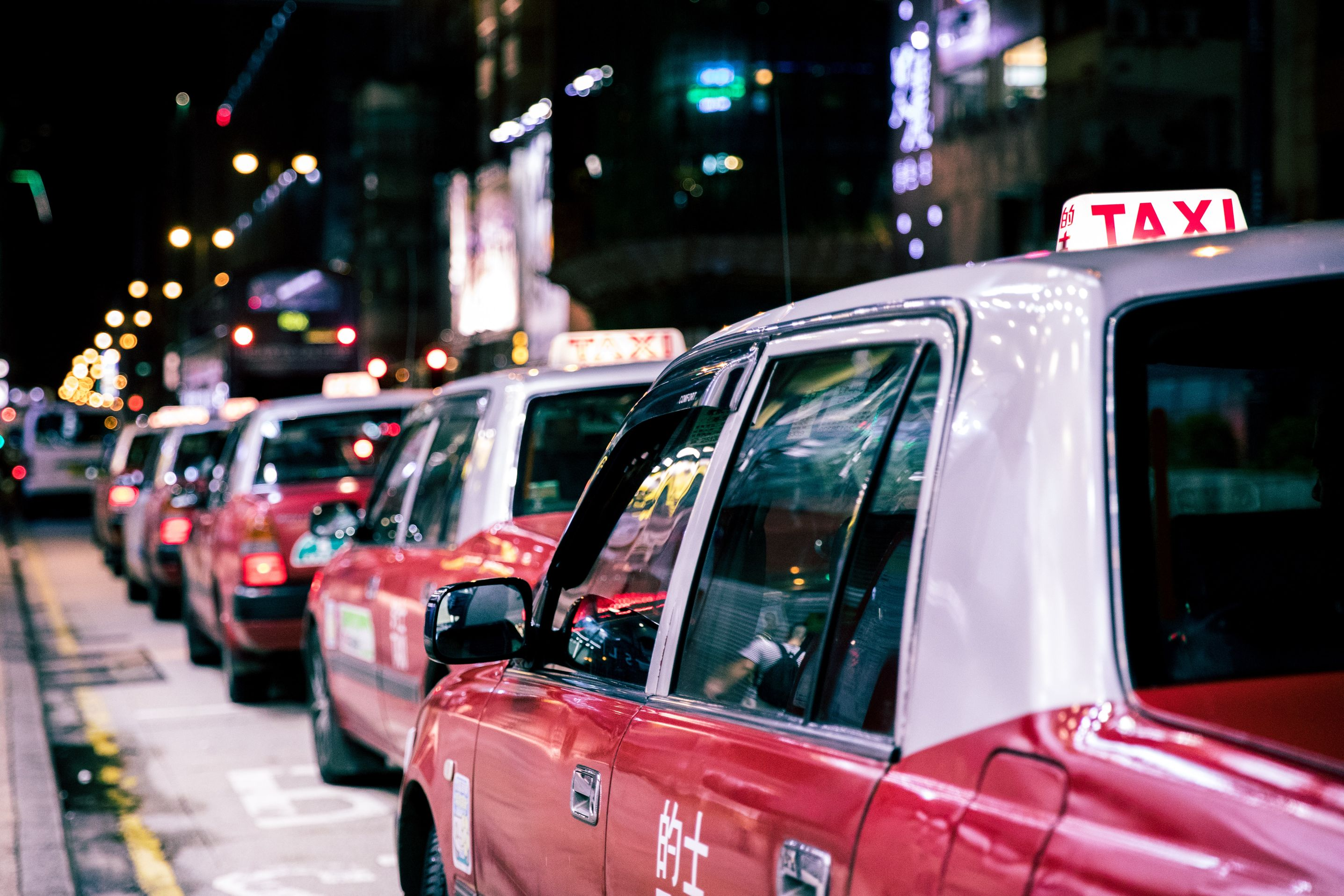 taxis in line at night