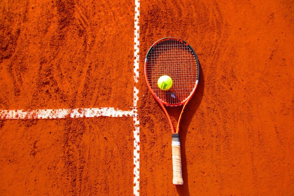 image of a tennis racquet and ball